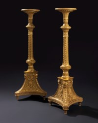 A PAIR OF GEORGE III GILTWOOD TORCHERES